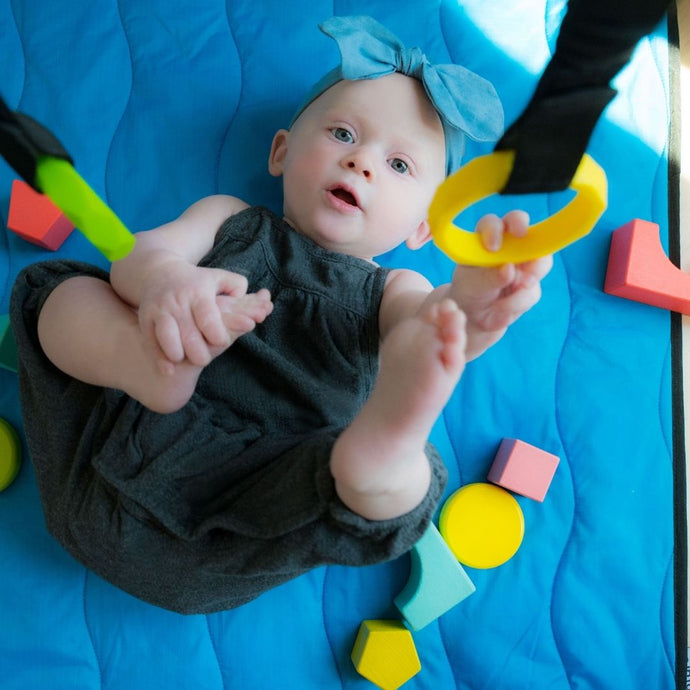 How to Get Your Baby Rolling with the Lay and Play Adventure Mat