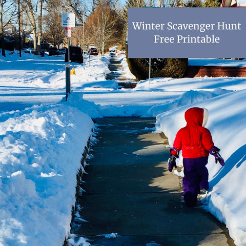 Toddler in red jacket and snow pants walking along sidewalk with snow on either side