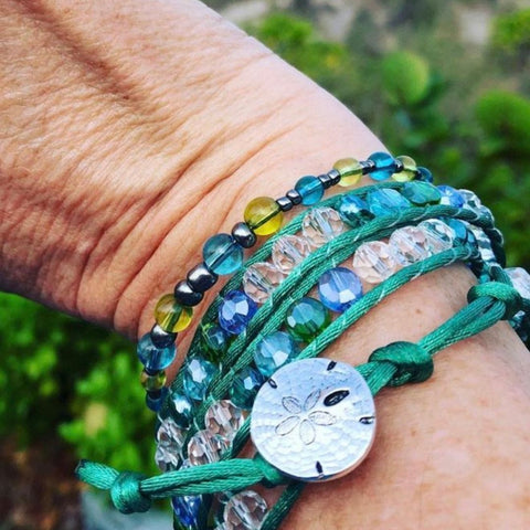 Woman's hand with bracelets made of sea glass