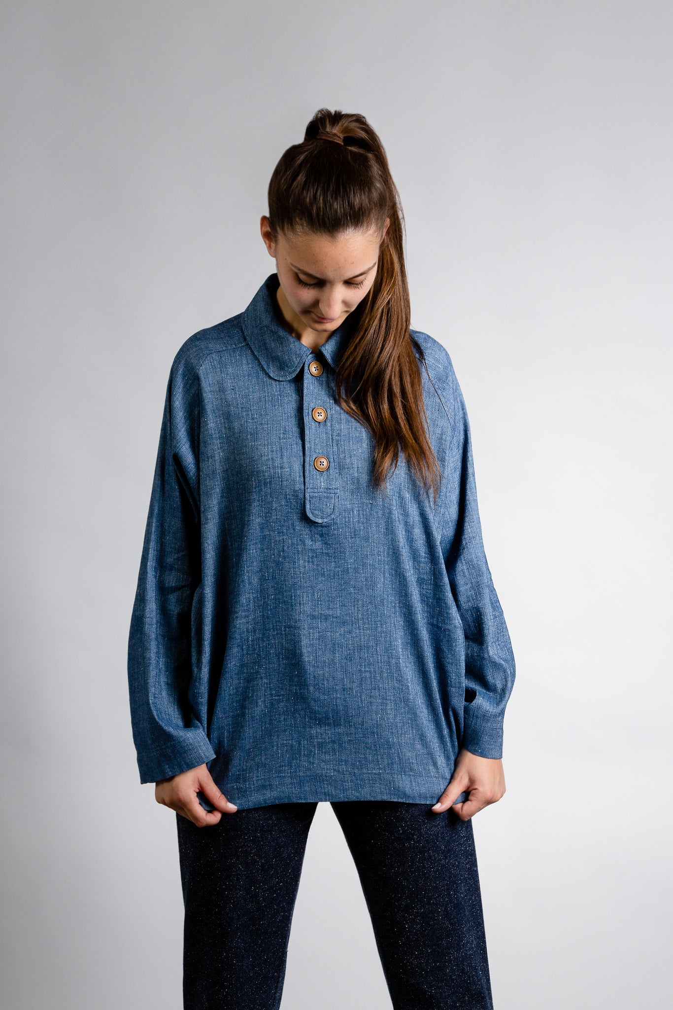 Oversized blue blouse with button-down tights.