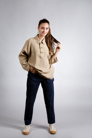 Oversized camel blouse with button placket.