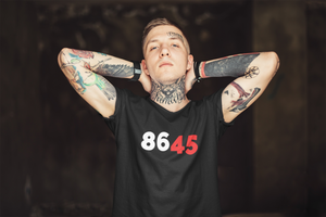 "Man wearing a t-shirt that says ""86 45"""