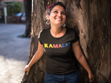 "Woman wearing a black T-shirt that says ""Kamala!"" In multiple colors"