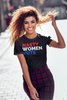 "Woman wearing black T-shirt that says ""nasty women vote"" in red white and blue lettering"