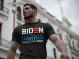 "Muscular man wearing black T-shirt that says ""Biden Harris 2020"" in red, white, and blue lettering"