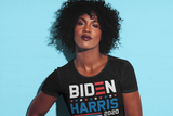 "Beautiful woman with bright lipstick wearing black t-shirt that says ""Biden Harris 2020"" in red, white, and blue lettering"
