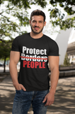 Man wearing black t-shirt that says Protect People