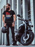 "Man in sunglasses wearing black T-shirt that says ""Joe Biden Kamala Harris 2020"" in red, white, and blue lettering standing next to a motorcycle"