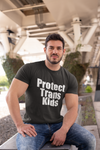 Man wearing black t-shirt that says protect trans kids