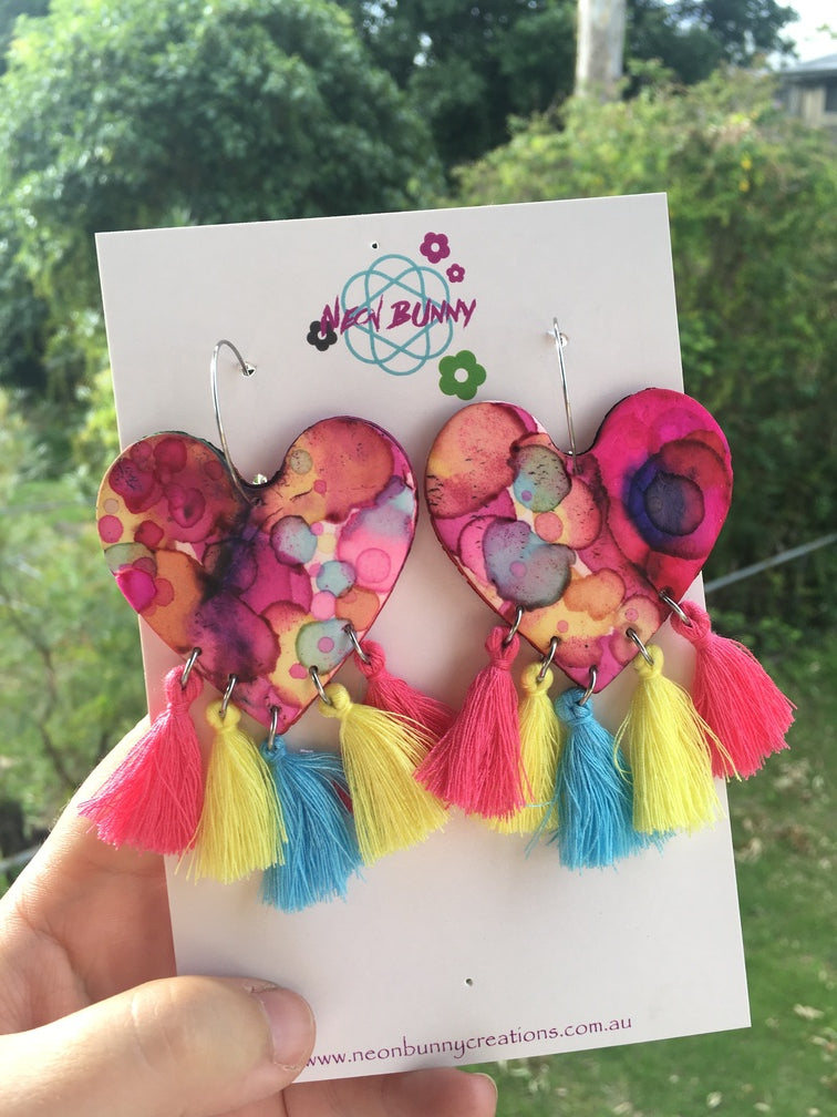 Tye dye rainbow heart dangles with tassels
