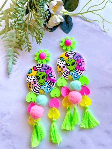 Alien world statement dangles with Pom poms and tassels