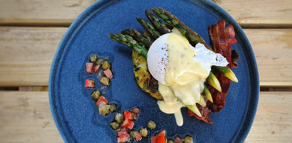 Bubble and Squeak Cakes with Poached Egg, Asparagus Spears and Hollandaise Sauce.