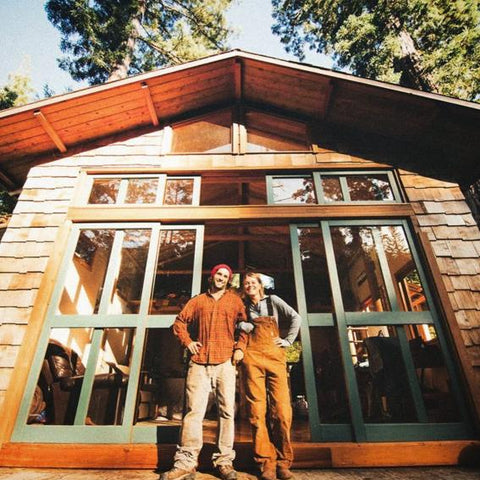 Tiny Life Supply ambassadors Ryan & Holly standing in from of their self-built cedar micro home