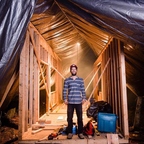 Tiny Life Supply ambassador Leo Hoorn standing in his partially constructed tiny house shell.