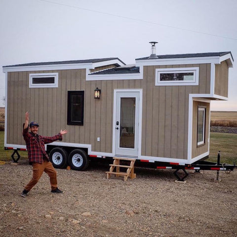 Tiny Life Supply ambassador Rémy Lamotte standing proudly in front of his unique self-built tiny house on wheels