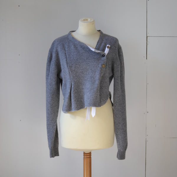 Pure wool asymmetric cardigan.