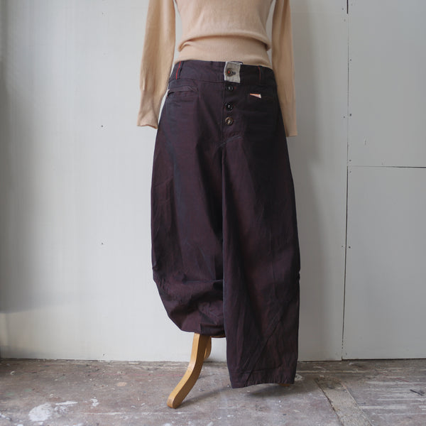 Beautiful aubergine colour curved trousers.
