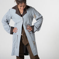 Pale blue 3/4 length coat with Parisian fabric insert