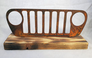 Rusted Metal Jeep Grill on Wood Base