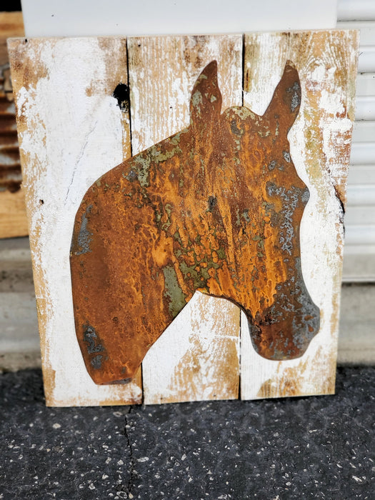 Rusty Metal Horse Silhouette on Board Back