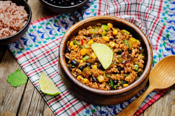 Bowl of black beans pepper cilantro lime brown rice