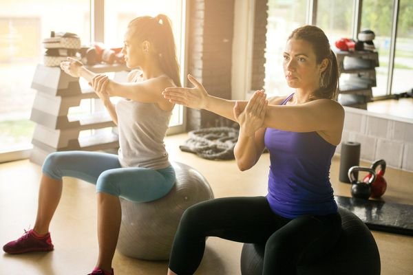 Young women on pilates ball