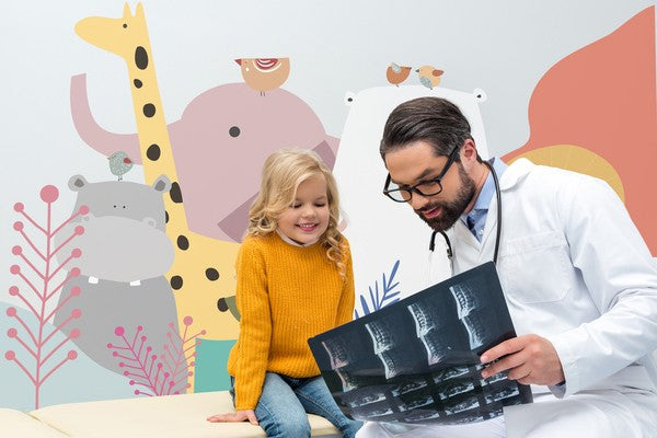 pediatrician showing x-ray scan to little girl
