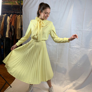 Pale yellow pleated midi dress