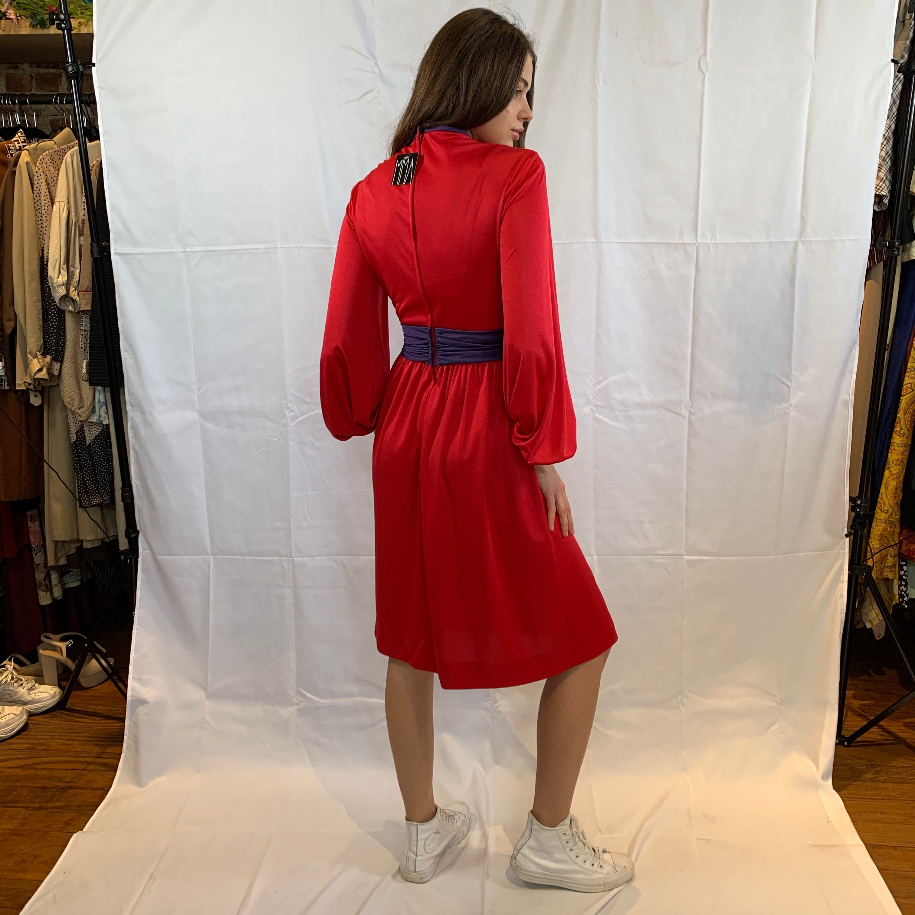 red draped collar with purple self belt
