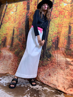 Black and white evening maxi with pretty pink belt