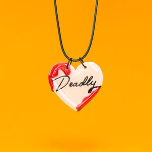 Deadly glow in the dark heart necklace