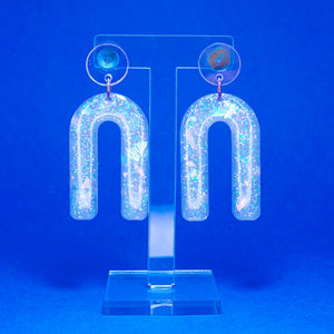 Iridescent glow in the dark arch dangles