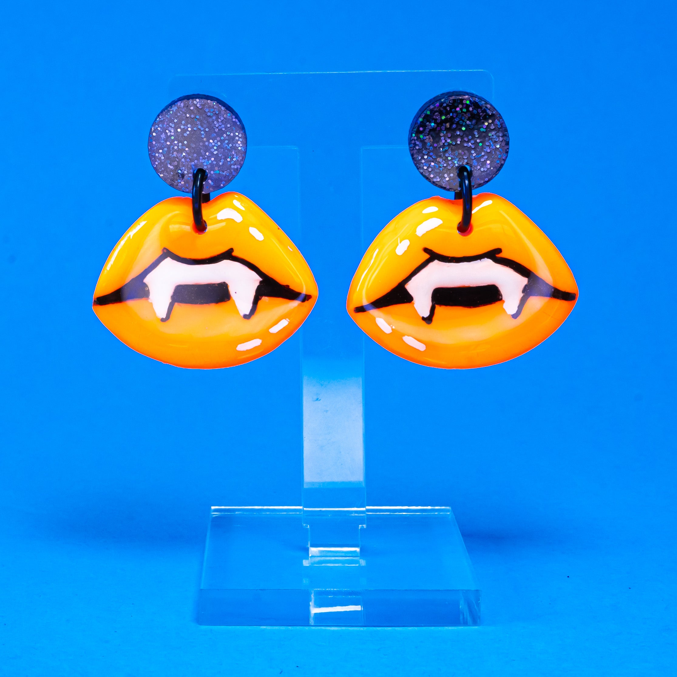 Neon orange vampire lip dangles