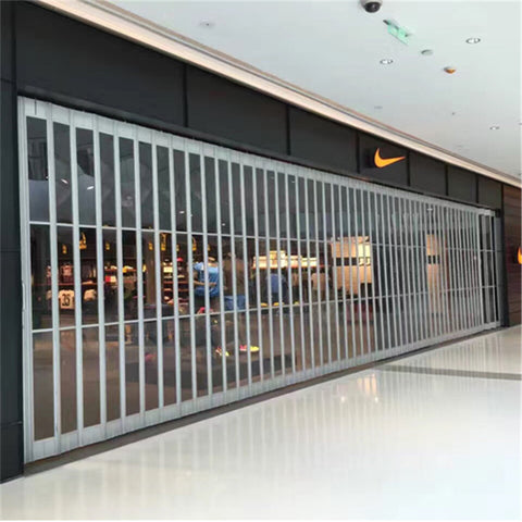 12*7 feet 300mm slat width polycarbonate folding door polycarbonate sliding door for mall on China WDMA