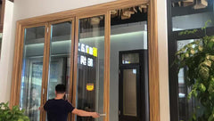 wood color Aluminium soundproof tri fold doors/glass folding double panel door on China WDMA on China WDMA