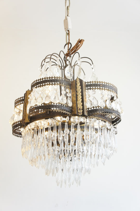 Pretty brass chandelier with arched frame