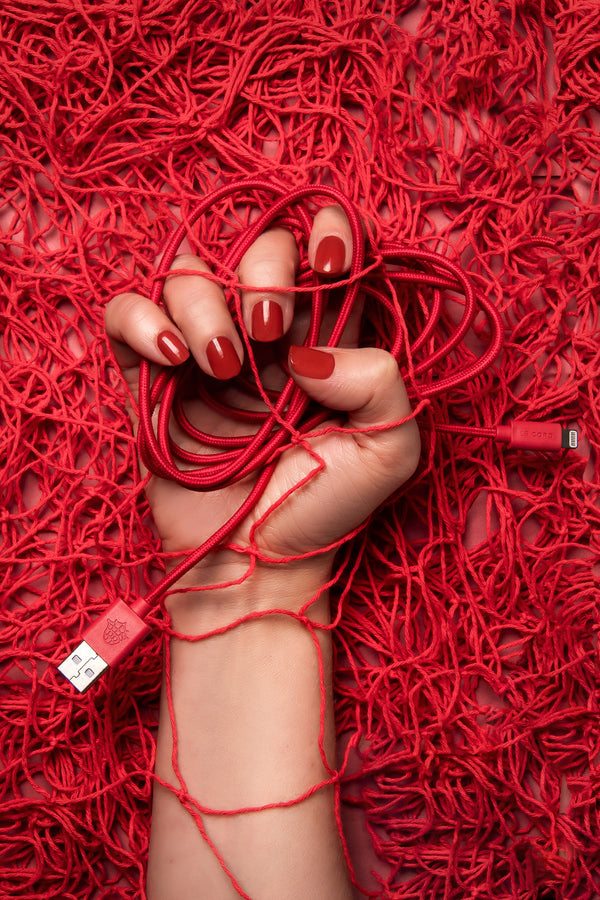 Red iPhone lightning cable · 2 meter · Made of recycled fishing nets
