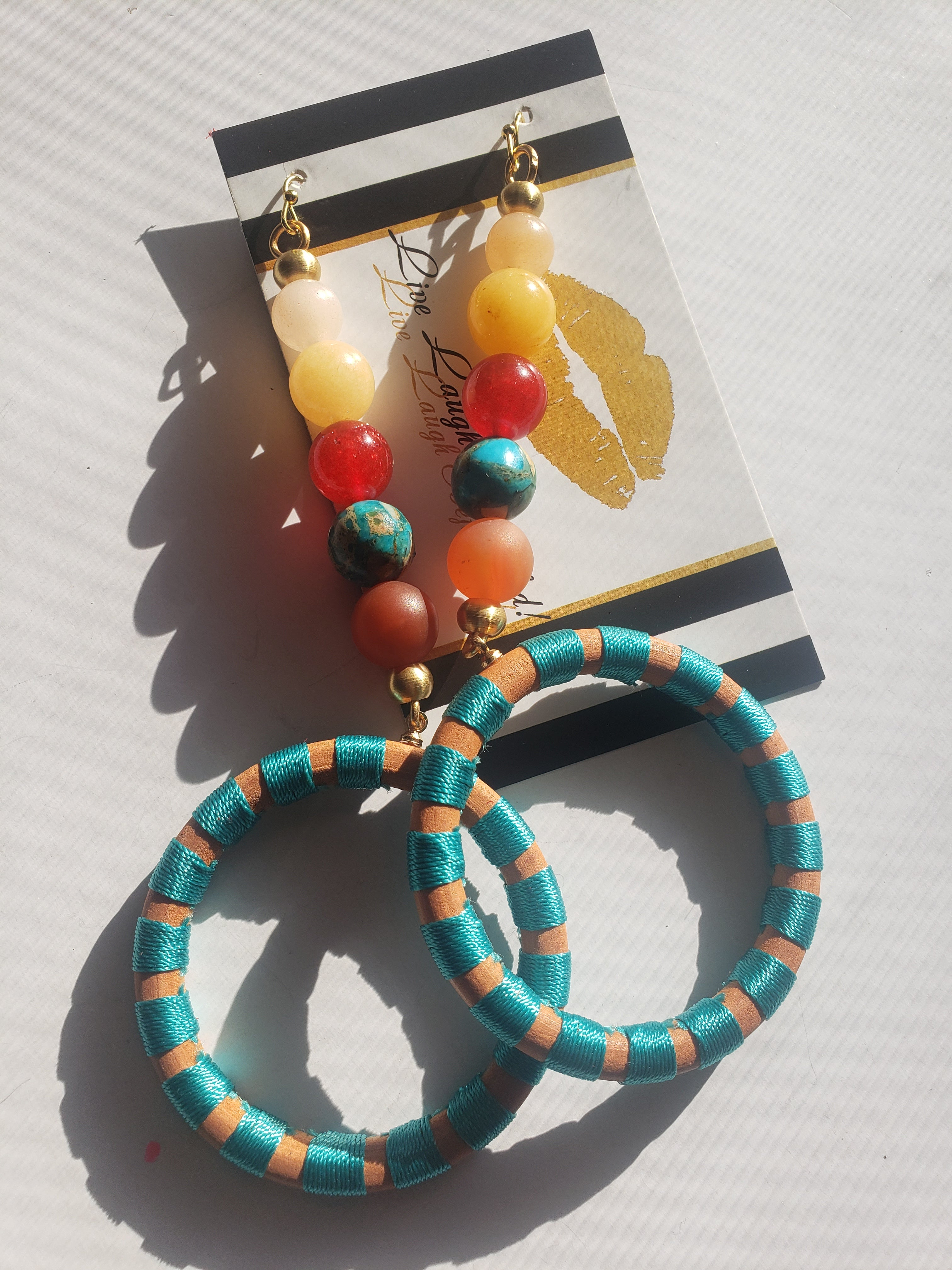 Brightly colored wood + natural stone hoops
