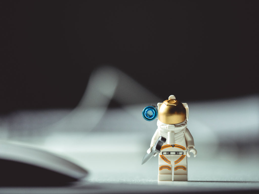 Lego action figure in space. Photo by JJ Shev on Unsplash