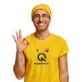 A smiling man in a fanny yellow winter hat in a yellow T-shirt with inprint: