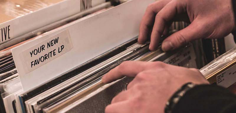 hand flipping through records