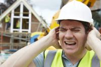 Construction Worker Man Wearing Yellow Vest Covering His Ears From Loud Noise