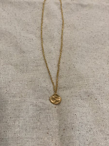 Tiny gold shell necklace