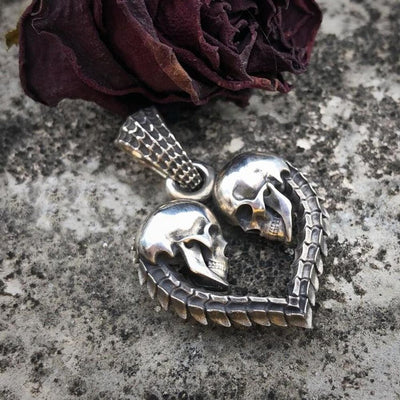 Double Skull Heart Pendant