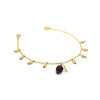 Gold charm bracelet with little flower buds and a cocoa pod, with red zirconia stones
