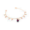 Rose gold charm bracelet with little flower buds and a cocoa pod, with pink zirconia stones