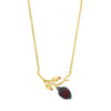 Branch shaped pendant necklace with a cocoa pod and flower buds, with red zirconia stones in gold vermeil