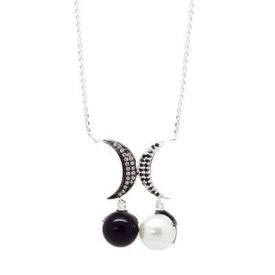 Crescent moon pendant necklace with monochrome zirconia stones and a black and white pearl charm, in sterling silver with ruthenium plating