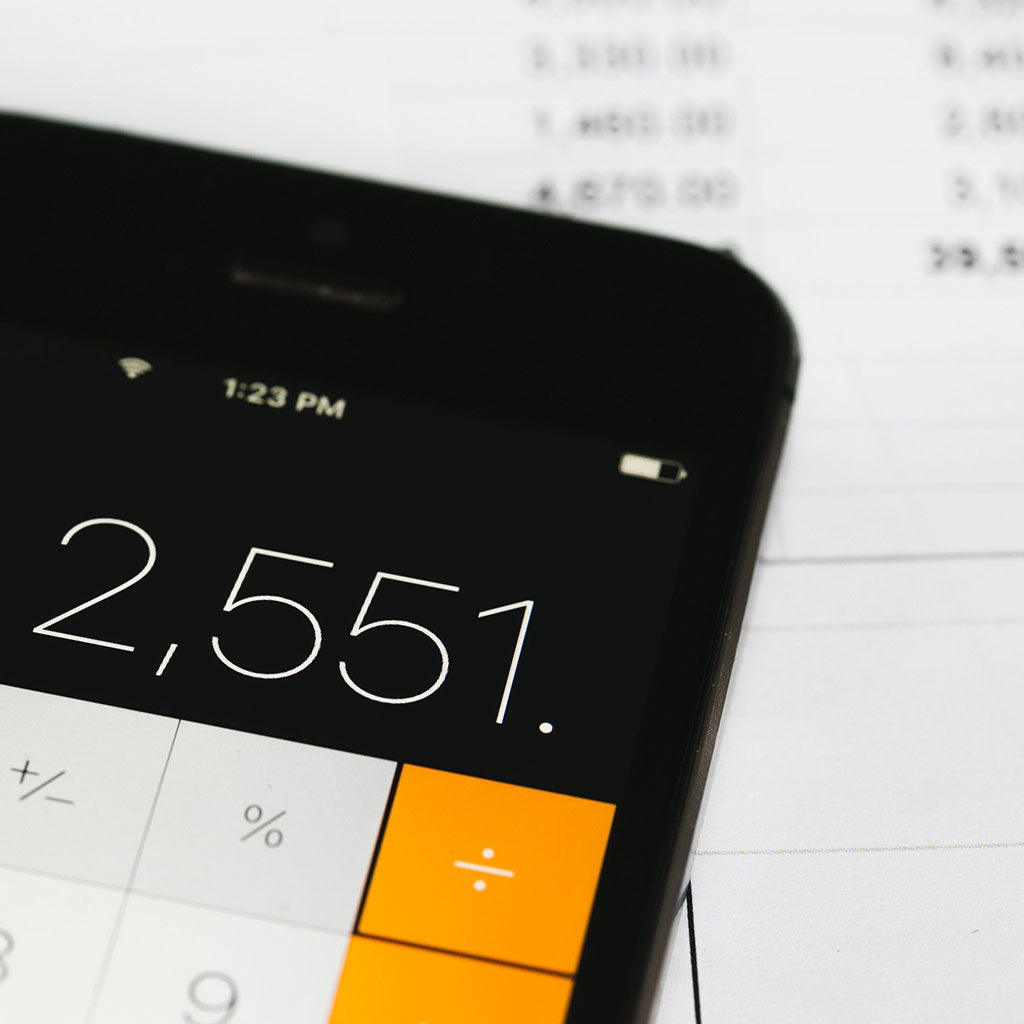 Calculating Time and Bills // Photo by Shopify Partners from Burst