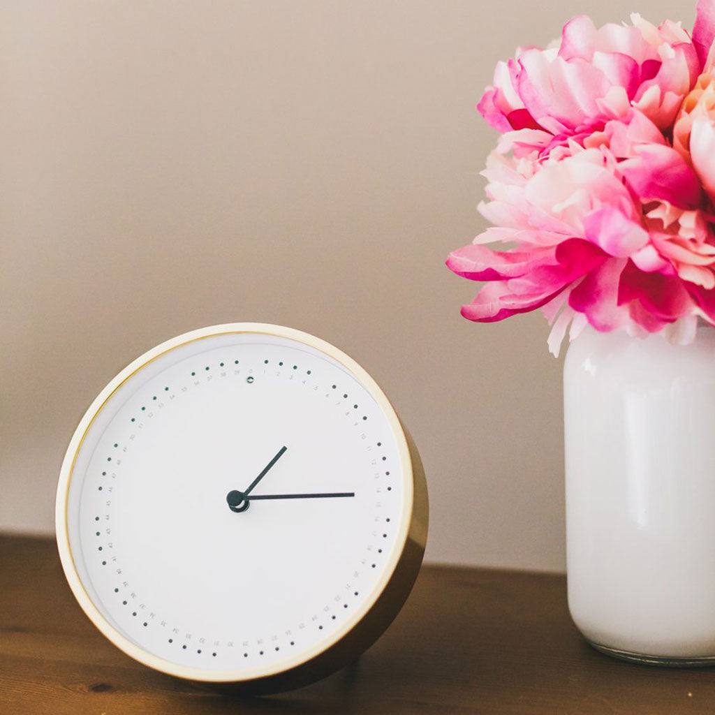 Image of Clock and Flowers to depict job costing // Photo by Sarah Pflug from Burst